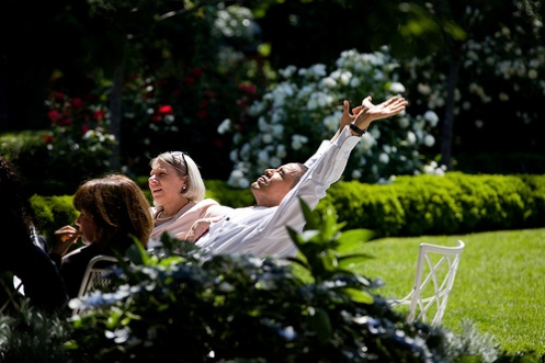 President Barack Obama stretches in the afternoon sun after moving a meeting with his senior advisors outdoors into the Rose Garden on a warm spring day, May 20, 2009. (Official White House photo by Pete Souza)